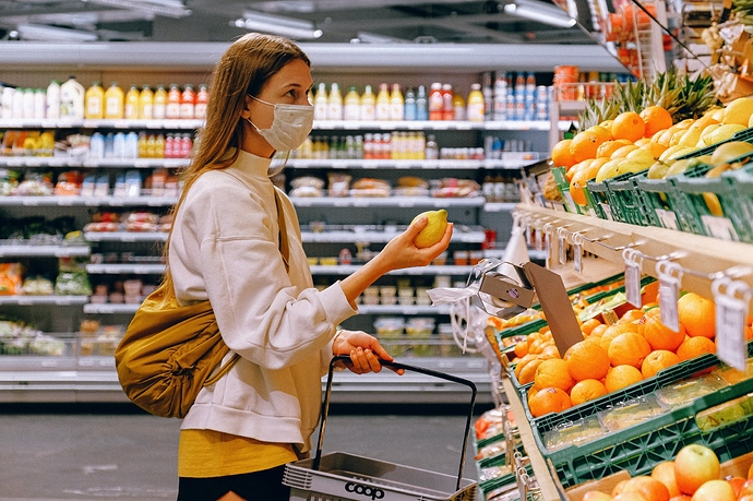 woman-in-yellow-tshirt-and-beige-jacket-holding-a-fruit-3962285_resized