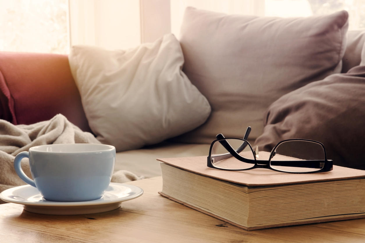 couch-mug-book-glasses-istock-wernerimages